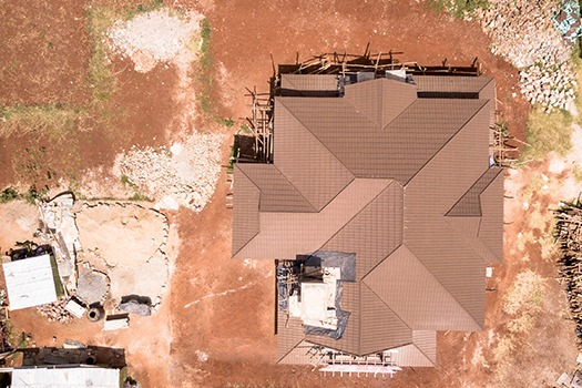 An aerial shot of a house under construction at Kijani Ridge