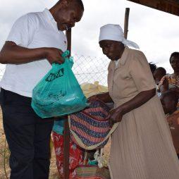 An eldery women receives her rations